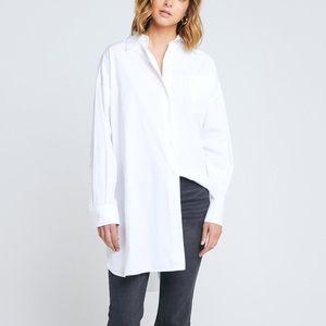 CAARA oversized tiered hem button down shirt